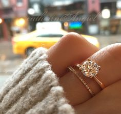 A sleek rose gold engagement ring and wedding band, with a round cut solitaire diamond, by Catherine Angiel