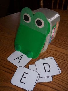 "Cascade Action Pacs dishwasher soap container. Put cards inside and use at circle time. ""Crocodile, crocodile down by the lake, going to reach right in and see what (letter or number) you ate."" LOVE this!"