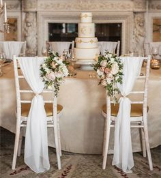 For some couples, simple isn't really their thing, and that's fine. If you're not so 'less is more' then you'll adore these seriously luxe-looking chairs, pictured at Weston Park. The fabric draping is chic on its own, but the addition of the flowers just takes it to the next level.