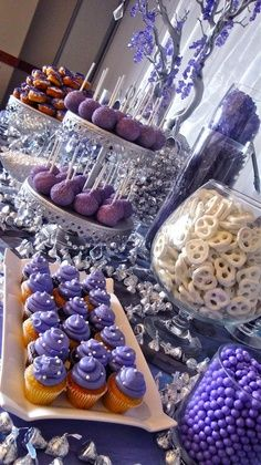 Lavender dessert table with white accents, beautiful wedding candy table.