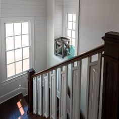 Our All-American Cottage's shop-built stair unit was built by The Heirloom Companies with red oak railing, newels and handrail. The balusters were carefully cut from poplar wood on a CNC router. All materials were purchased in the USA. | Photo: Fred Rollison | thisoldhouse.com