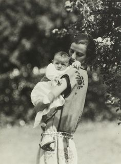 Peggy Guggenheim with son fils Sinbad, 1923 by Man Ray