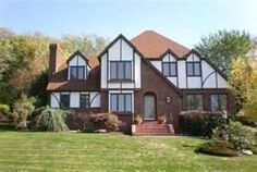 """TUDOR house plans are drawn loosely from late medieval English homes. The term """"Tudor Revival"""" in American architecture generally covers the blend of a variety of elements of late English medieval styles, including Elizabethan and Jacobean. Most Tudor house plans have stucco or masonry exteriors that are accented by ornamental half-timbering, massive chimneys and steep gable roofs. Other common features include arched entries and tall, narrow window groups."""