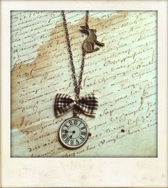 Alice in Wonderland Necklace. White rabbit, clock and bow. I NEED IT