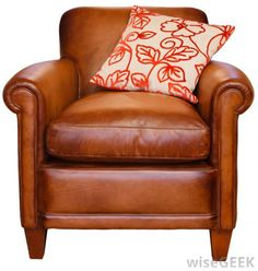 brown glossy leather arm single sofa chair with pillow-red cream leaves spiral patterned pillow-white background