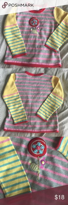 Hanna Andersson Sweater EUC. It's been worn but you cannot tell! Flower and candy appliqué detail. Roll hem sleeves and neck. Cute stripes and vibrant colors! Hanna size 110. US is about 5/6. Hanna Andersson Shirts & Tops Sweaters