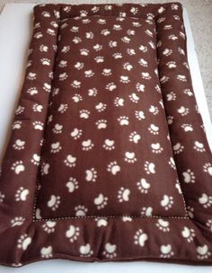 Brown with Cream Paw Prints Dog Crate Pad Fleece by ComfyPetPads #pawprints