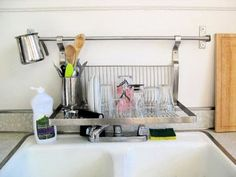 At a friend's new apartment last weekend, we noticed some great space-saving solutions in her not-so-huge kitchen. Rather than take up precious counter space with a dish drying rack, she uses a hanging IKEA shelf (sorry, we don't see this one online) directly over the sink for drying dishes.