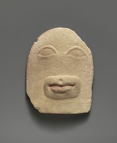 Limestone votive relief of eyes and a mouth, Cypriot, 4th or 3rd century BCE