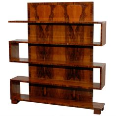 Art Deco Walnut Bookcase with Tall Back   From a unique collection of antique and modern bookcases at http://www.1stdibs.com/furniture/storage-case-pieces/bookcases/