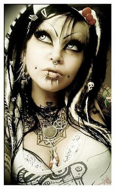 Goth/industrial, girl with white and black dread falls