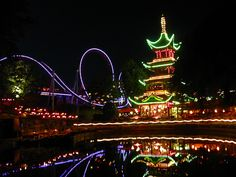 Tivoli Gardens at night is a must see! Tivoli is located in Copenhagen, Denmark.  Tivoli is one of the oldest amusement parks in the world—and the original inspiration for Disneyland. Tivoli opened its doors in 1843 and has been at the heart of Copenhagen life ever since.