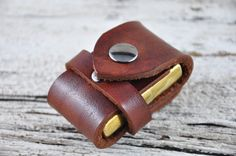 http://www.etsy.com/listing/86291002/zippo-lighter-leather-belt-case