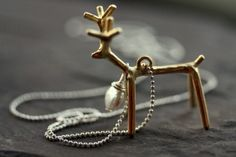 Reindeer pendant Giveaway! http://fulllivesflatbroke.com/2013/11/05/nighbluey-jewelry-reindeer-necklace-giveaway/