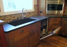 Soapstone countertops and oak cabinets