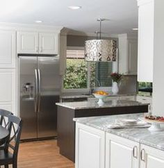 This kitchen began as a very cramped, dated space.  By taking down just one wall that separated the kitchen from the small dining room, we made room for a beautiful, large kitchen.