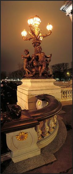 a view of the cherub details on the Pont de alexandre III bridge in Paris by Arnaud Frich.
