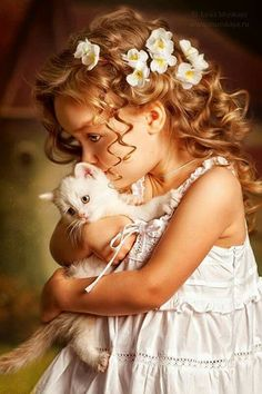 little girl with a kitten; my favorite pose, expressions, hair, flowers in hair, white dress, ruffles.