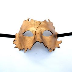 Another of our Handcrafted Original Leather Masquerade Masks for Men ( that look just as good on women..!), formed using the highest quality leather over an authentic Venetian mask base and finished with a gold finish and black satin ribbons.