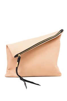This oversized leather fold clutch really can go perfectly with anything. LBD, cut-off shorts and a t-shirt... anything! It's soft and supple, will easily fit your iPad or e-reader, with plenty of room for personal items, phones, etc. The chic wristlet keeps you hands free whenever you need to be.