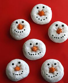 snowman donuts...candy corn for noses and icing dots for eyes. cute idea for a holiday/winter party.