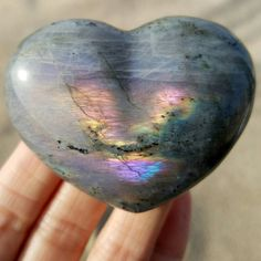 Bring some rainbow love to your life with a chunky labradorite crystal puff heart for your crystal collection! Labradorite is a wonderful chatoyant feldspar crystal to use for third eye meditation, energetic balancing and aura protection. This beautiful heart has shades of blue, gold, violet, purple, emerald green and sky blue!  This labradorite puff heart palm stone will mesmerize you with its beauty and help you to see the light in all situations. I hand pick each crystal in my shop to…