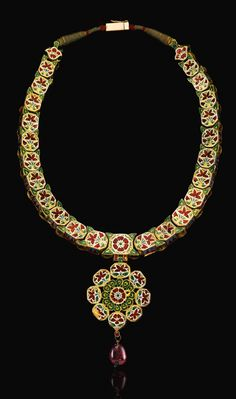 The enamel back detail from a gemset Navratna necklace; decorated with flowering plants and floral rosettes in white, green and red enamel, cabochon ruby drop pendant. India, Late 18th century