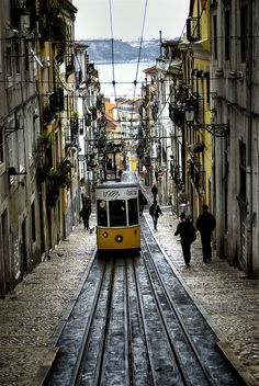 Tram on a hilly street in Lisbon, Portugal