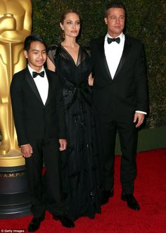 #TuxedoWatch Brad Pitt with son Maddox. Like father, like son! Both looking great in their classic tuxedos