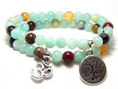 Beautiful Om set of 2 Stacked Bracelets made with 6mm Genuine Amazonite with a Tree of Life Charms and an Om Charm. Calming Bracelet. Amazonite Properties: A calming stone. Good for spiritual growth,