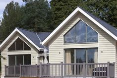 Cedral Weatherboard used on new development - Beige Exterior Wall Cladding, House Cladding, Timber Cladding, Cladding Ideas, External Cladding, Garage Exterior, Bungalow Exterior, Cedral Weatherboard, New England Style Homes