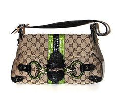 GUCCI by Tom Ford Bag Monogram Jeweled Snake Head Limited Edition An exceptional Tom Ford for Gucci signature bag. Gorgeous flap bag crafted of Gucci GG monogram canvas with wide central stripes of black and neon green crocodile skin.   Black crocodile adjustable shoulder strap and corner plates. Amazing handcrafted jeweled snake heads with Swarosvski on the front.   Collection: SS 2004  Pristine condition. On sale at La Bourse du Luxe. Ford Ltd, Crocodile Skin, Head & Shoulders, Monogram Canvas, Neon Green, Signature Style, Tom Ford, Messenger Bag, Shoulder Strap