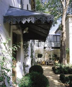 Courtyard...zinc awning with fretwork...