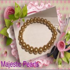 "Majestic Faux Pearl 7-8"" Stretch BraceletCHAMPAGNE NEW Majestic Brand Faux Pearl 7-8"" Stretch Bracelet CHAMPAGNE. BRAND NEW WITH TAGS.  A Beautiful CHAMPAGNE Faux Pearl Stretch Bracelet. Photos do not do justice of the pretty color.  A very nice looking bracelet to wear dress up or casual.  A Neutral color that Will go with any other color.   • Bracelet measures 7 inches but stretches a lot.  Will fit a larger wrist.   • Made in China. MAJESTIC PEARLS Jewelry Bracelets"