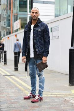 Shop this look on Lookastic:  https://lookastic.com/men/looks/denim-jacket-hoodie-crew-neck-t-shirt-skinny-jeans-low-top-sneakers/13142  — White Crew-neck T-shirt  — Navy Denim Jacket  — Black Hoodie  — Blue Ripped Skinny Jeans  — Burgundy Low Top Sneakers