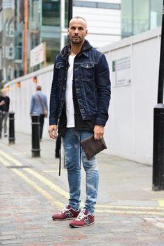 Shop this look on Lookastic:  https://lookastic.com/men/looks/denim-jacket-hoodie-crew-neck-t-shirt-skinny-jeans-low-top-sneakers/13142  — White Crew-neck T-shirt  — Navy Denim Jacket  — Black Hoodie  — Blue Ripped Skinny Jeans  — Burgundy Low Top Sneakers