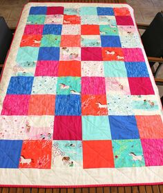 Single Bed 'Wee Wander' patchwork quilt made from Michael Miller Sarah Jane collection designer fabrics.