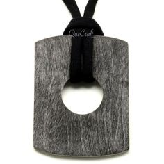"""A beautiful pendant handmade from buffalo horn. Matte finish. Lightweight. Actual colors may vary. 3.27"""" (8.3cm) length x 2.64"""" (6.7cm) width."""