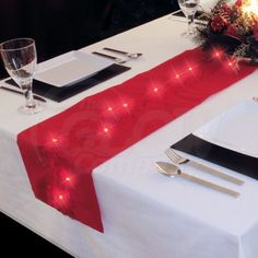 """Led Table Runner This rich red table runner is stuffed with festive LED lights, making it an ideal compliment to table settings for Christmas parties or just as an interesting centrepiece £10.99 £9.16 Ex.VAT"""