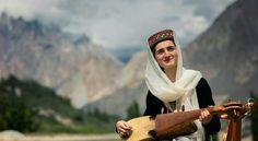Hunza girl playing Rabab in Gojal Hunza Valley gilgit Pakistan