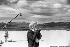 Classic shot of Marilyn Monroe (in her Lee Storm Rider denim jacket) seemingly oblivious to the world on the set of The Misfits -- image by photojournalist Eve Arnold.