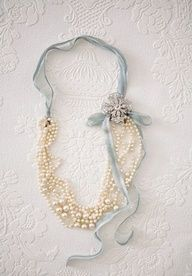 Fold beads in half, tie ribbon, add charms and flower to hide fold. cute