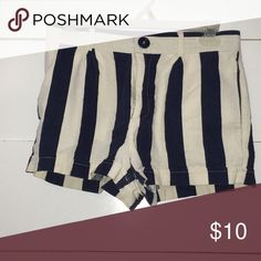 A Pair Of Mid-Rise Shorts A Pair Of Mid-Rise Navy Blue & White Striped Shorts With Slanted Front Pockets, Back Welt Pockets, Whiskering On The Front, & A Cuffed Hem. You May Accessorize With a Nice Tan, Brown, Or Light Orange Belt. Forever 21 Shorts