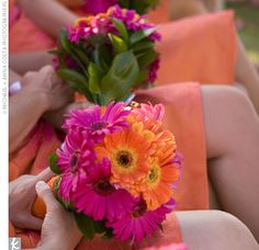 vibrant bouquets of pink and orange gerbera daisies hand-tied with orange…
