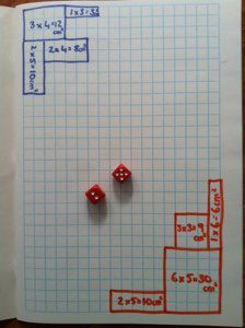 Fill in Area Game: 2 or 3 players Each player chooses a color pencil they will use. Players take turns rolling the dice, using the numbers that they rolled to draw the perimeter of a rectangle or square & writing the area in the middle of the shape. Game ends when players run out of room to draw. Winner is the player who has used the largest area. - Looks like a good way to pass time or to help a kid learn about multiplication and area.