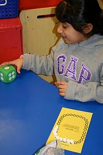 """Community Helpers- After Dentist visit kiddos roll dice and place that many mini-marshmellows on """"teeth""""."""