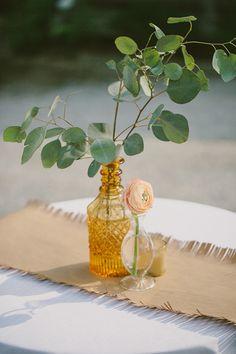 simple antique bottle centerpieces   Paige Jones #wedding