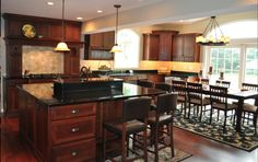 Cherrywood cabinets with black granite countertops