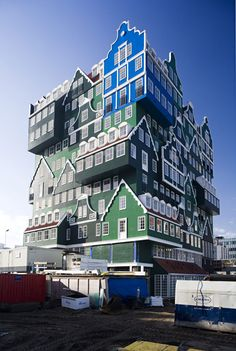 """The Hotel Inntel in Zaandam, Netherlands by Wilfried van Winden. The 12-story hotel with 160 rooms, a pool, and wellness center has been designed to look like stacked houses. Particularly eye-catching is the """"The Blue House,"""" inspired by the artwork that Claude Monet painted in Zaandam in 1871."""
