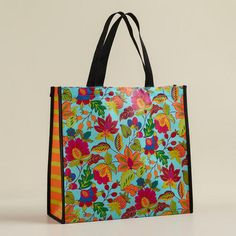 """Love these reusable totes at World Market.  Only $3.99 and a great way to """"wrap"""" a gift!  (Turquoise Floral Henri tote)"""